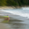 Boy on boggy board washed up in surf motion blur background Mount Maunganui