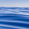 Abstract background deep blue ocean motion defocused to horizon