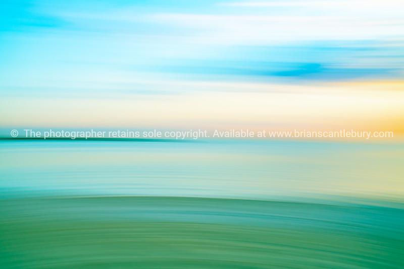 Beach abstract in soft hues St Kilda Beach back-lit by setting sun
