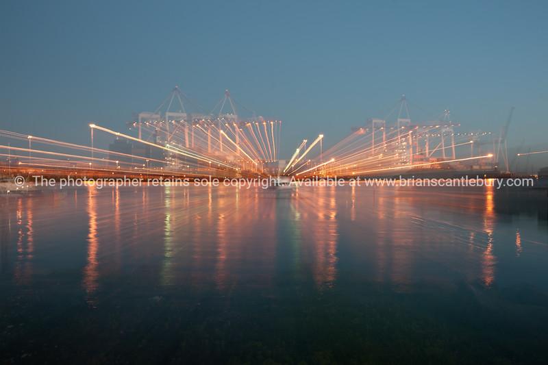 Port of Tauranga, light streams across the harbour