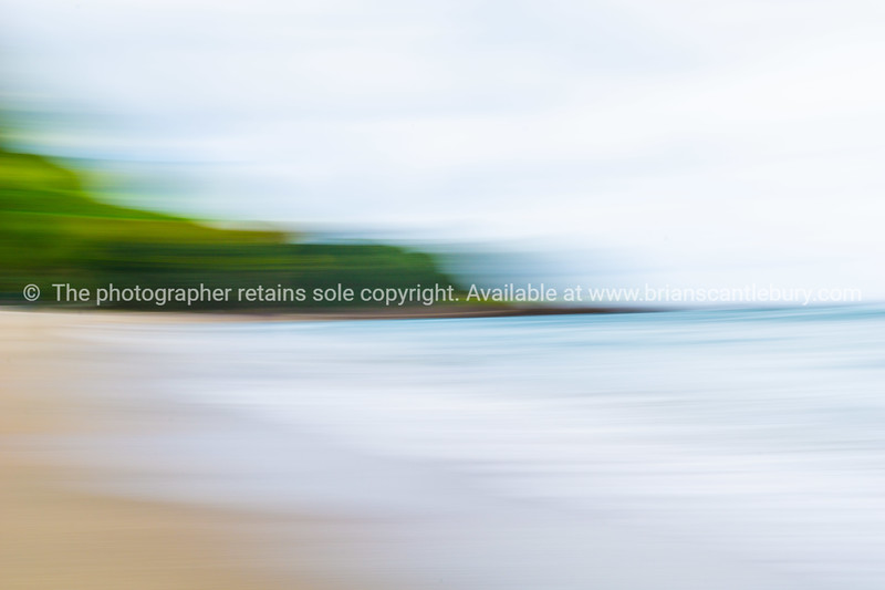 Coastal motion blur abstract with sun  shimmer across sea