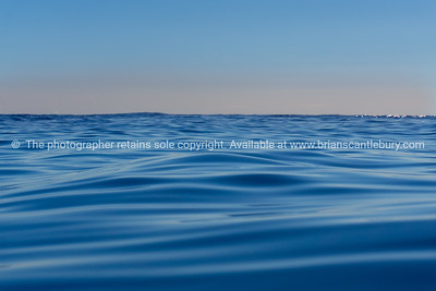 Abstract background deep blue ocean motion defocused to pink sky on horizon
