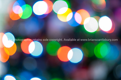Christmas lights colorful bokeh defocused abstract pattern.