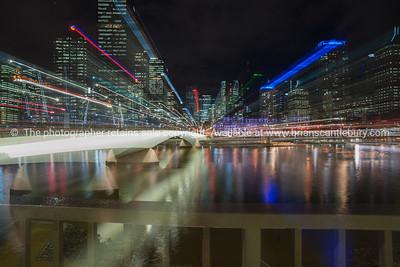 Brisbane Victoria Bridge catches night lights standing out against the dark night background