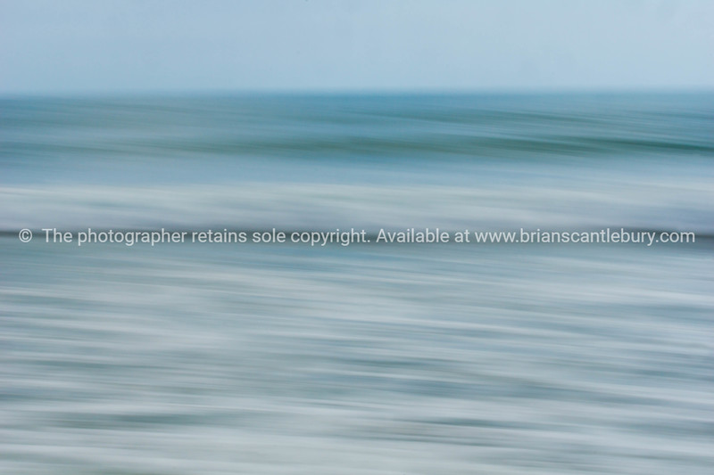 Coastal abstract motion blurred ocean waves blue tones background