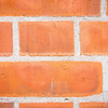 Red bricks in wall.