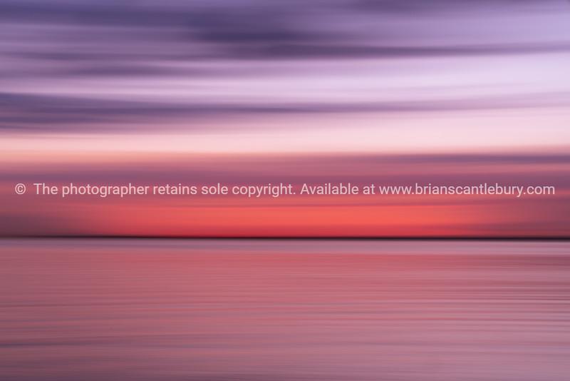 Abstract St Kilda Beach back-lit by setting sun