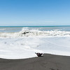 Waves crash onto South Pacific beach in New Zealand.