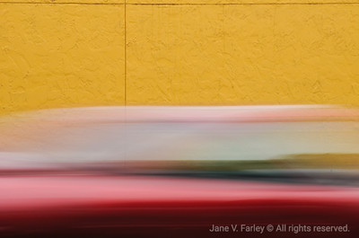 Blur Car and Yellow Wall