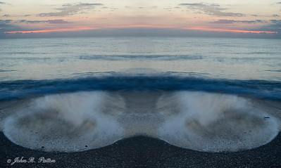 Abstract, mirrored wave on beach