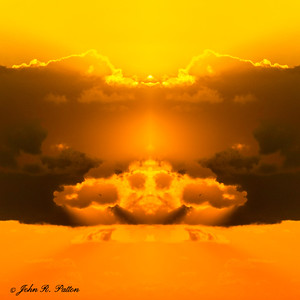 Abstract, mirrored clouds at sunrise