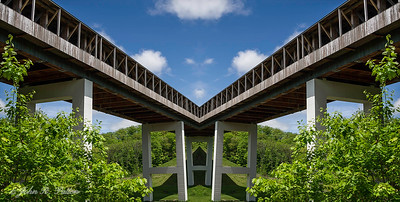 Abstract, mirrored covered bridge