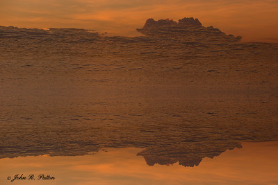 Abstract, mirrored water and sky