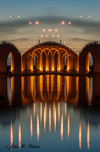 Abstract, mirrored bridge at dusk