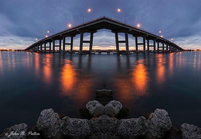 Abstract, mirrored bridge