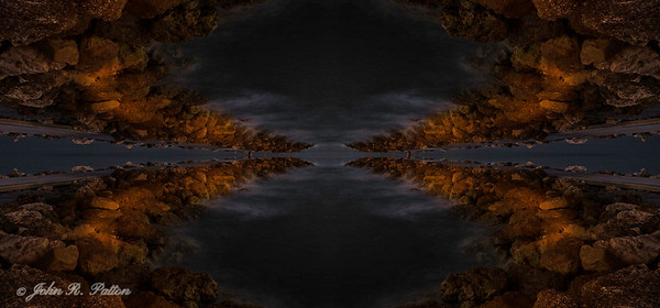 Abstract, mirrored stone jetty
