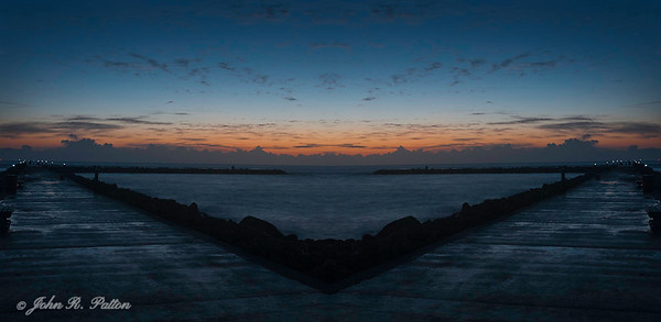 Abstract, mirrored image of rock jetty
