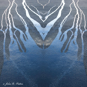 Abstract, mirrored oil slick