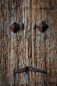 Face on door