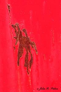 Rust pattern on dumpster