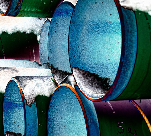 Feb 21 - Metal Abstract #3 - this is the third image in this series of stacked metal pipe.   I like the first two images better - but thought I would post this one also.  The specks in the image are snow flakes.<br /> <br /> Thank you for all the response on this series.