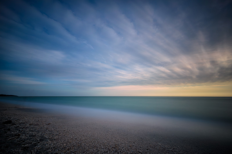 Long exposure of waves and clouds at sunset on Bowman's Beach, Sanibel Island, Florida