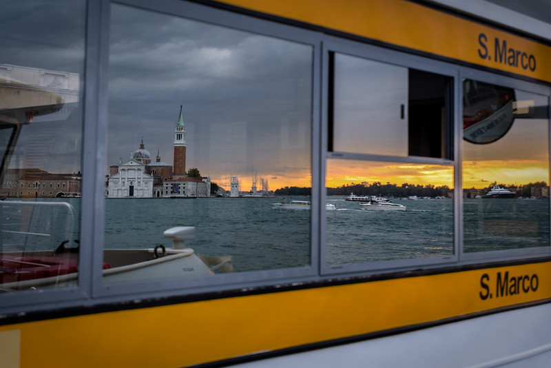 Reflection of Church of San Giorgio Maggiore in the window of the San Marco vaporetto stop, Venice, Italy