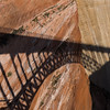 Glen Canyon Dam Bridge shadow on the Glen Canyon Dam and nearby rock at sunrise