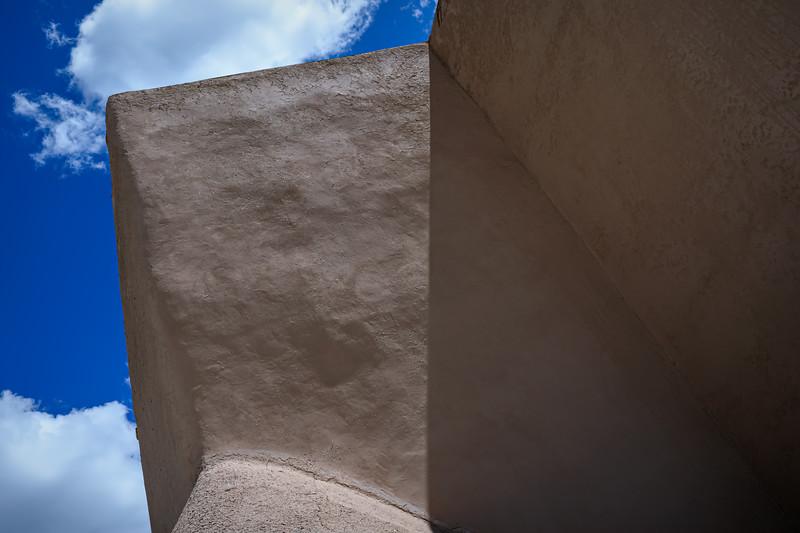 Outside adobe walls of the rear exterior of San Francisco de Asis Mission Church, Ranchos de Taos, New Mexico