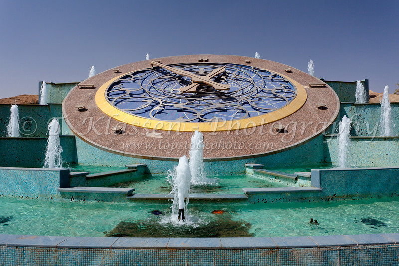 A large outdoor decorative clock with water fountains in Al Ain, UAE, Persian Gulf.