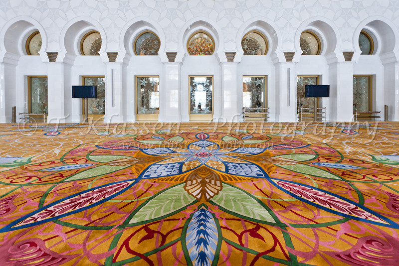 Interior prayer room architecture and carpet in the Sheikh Zayed Grand Mosque in Abu Dhabi, UAE.