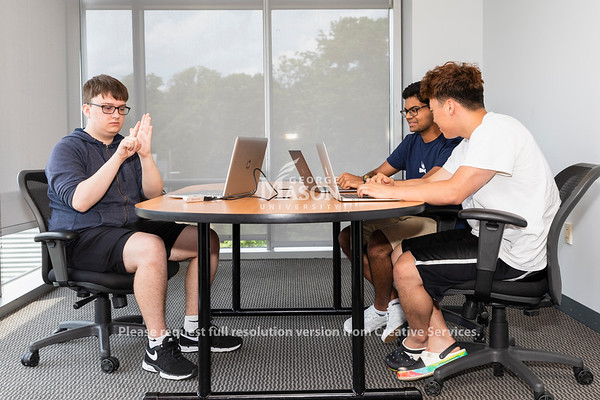 Frederick Olson, Sai Gurrapu and Dom Huh are part of a summer research project on automatic multimodal sign language recognition. Photo by Lathan Goumas/Strategic Communications