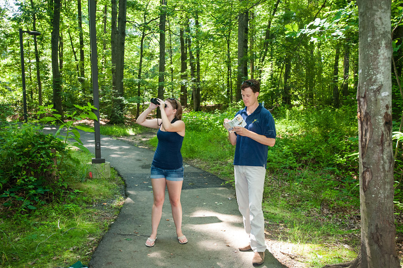 Student Samantha Dilday and Professor David Luther observe the behavior of birds for research on the effects of urban environments on the calls and songs of birds at Fairfax Campus. Photo by Alexis Glenn/Creative Services/George Mason University