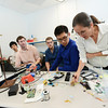 Engineering students design an anti-stutter microcontroller device under the guidance of Nathalia Peixoto, assistant professor of electrical and computer engineering. Pictured left to right: Jon Posey, Steve Lim, Jim Beatty, Thomas Parnell, JS Ham and Nathalia Peixoto.  Photo by Evan Cantwell/Creative Services/George Mason University