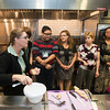 Nutrition and Food Studies students and professors assist during a demonstration of food preparation and cooking for Women, Infants, and Children (WIC) trainees at the Mason Nutrition and Food Studies kitchen. Photo by Alexis Glenn/Creative Services/George Mason University