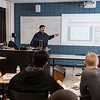 "Professor Amid Jazaeri teaches a Physics class where he ""flipped"" the instruction format, also called ""Lectures Online Group-work In Class"" (LOGIC), helping students with homework in class, and assigning video lectures for students to watch outside of class. Photo by Alexis Glenn/Creative Services/George Mason University"