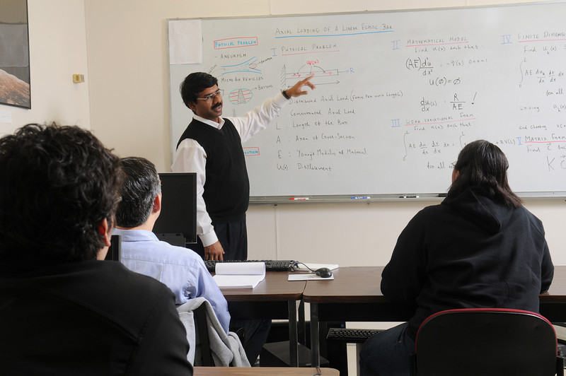 Mathematics faculty, Padhu Seshaiyer, teaching class.  Photo by Evan Cantwell/Creative Services/George Mason University