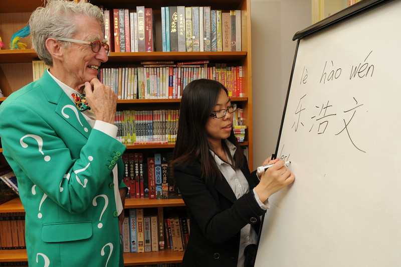 "Instructor Zhang teaching Matt ""the question guy"" Lesko how to write his name. Photo by Evan Cantwell/Creative Services/George Mason University"
