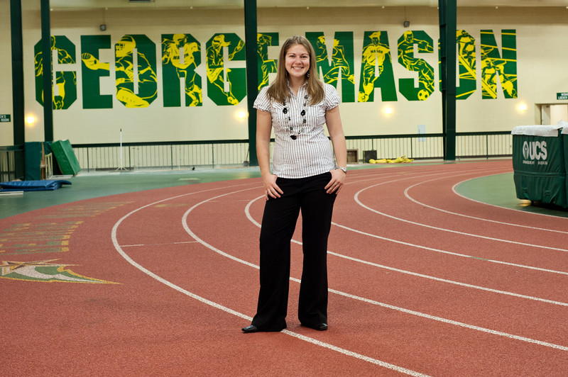 Junior Kristen Zimmerman, sports management major and business minor, poses for a portrait at the Field House on Fairfax Campus. Photo by Alexis Glenn/Creative Services/George Mason University