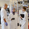 Mai Abdel-Ghani (center) mentors Kirsten Norrell (right) and Jason Lipof, MD Candidates, at The George Washington University School of Medicine and Health Sciences working in the Center for Genetic Medicine Research at Children's National Medical Center. Photo by Evan Cantwell/Creative Services/George Mason University