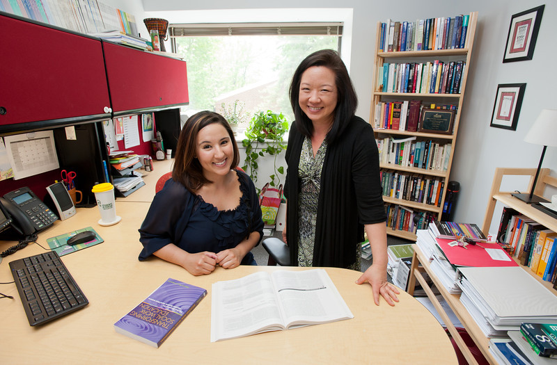 OSCAR/URSP portrait of student Kimberlee Velazquez (L) working on her research with Prof. Emily Ihara at the Social Work office. Photo by Alexis Glenn/Creative Services/George Mason University