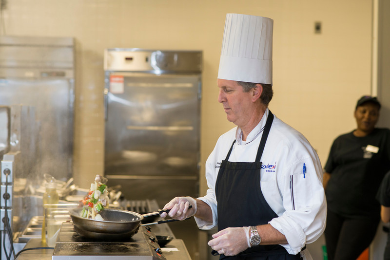 Sodexo Executive Chef Peter Schoebel prepares food at the Hot Spot in the Johnson Center. Photo by Alexis Glenn/Creative Services/George Mason University