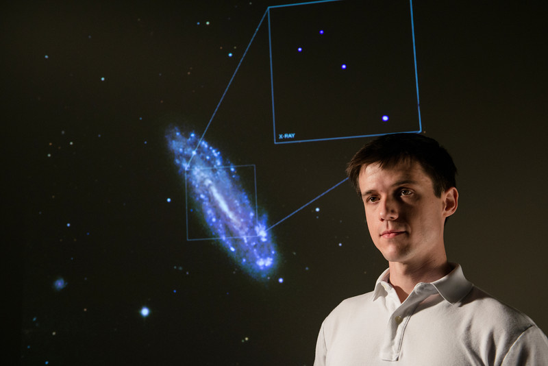 Nathan Secrest, PhD student in physics discovers a black hole in spiral galaxy NGC 4178. Photo by Evan Cantwell/Creative Services/George Mason University