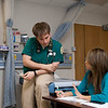 Nursing student Kees Slot works in a nursing lab at Fairfax Campus. Photo by Alexis Glenn/Creative Services/George Mason University