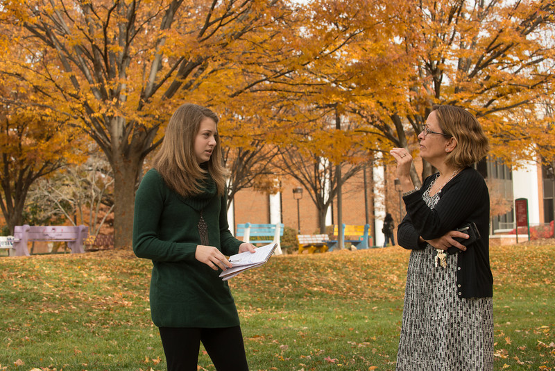 Stephanie Skees discusses gerontology research with mentor and Associate Professor Cathy Tompkins. Photo by Evan Cantwell/Creative Services/George Mason University