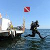 Divers on the University of West Florida archaeology research barge over the Luna shipwreck sites.
