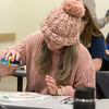 Students examine and learn about lionfish in the new course, Gulf Coast Business Issues: Lionfish Markets, on January 30, 2018 taught by Dr. Bill Huth, a distinguished University professor, and Dr. Felicia Morgan, an associate professor in the College of Business.