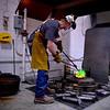 Students pour molten bronze and aluminum into plaster molds in the Boor Sculpture Studio.2013 Professor: Roger Bisbing Photographer: Danielle Dietrich