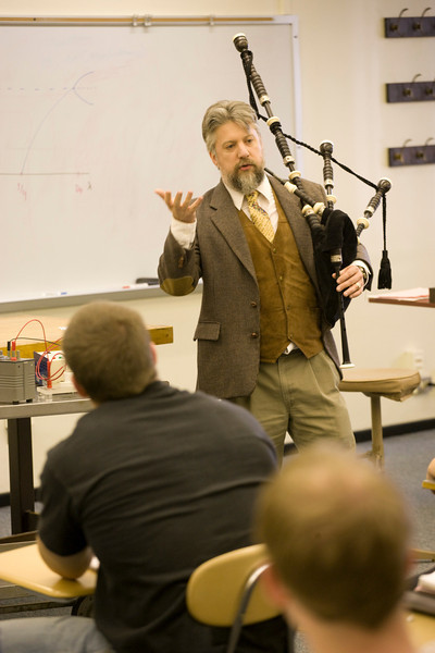 Physics Professor K. Earle teaches students about physics both in the classroom and outside the classroom with bagpipes.  Photographer: P. Scott Barrow.