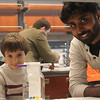 Institute postdoctoral associate Arun Richard Chandrasekaran and Consortium student see result of liquid chromatography experiment.
